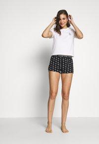 Calvin Klein Underwear - CK ONE WOVENS COTTON SLEEP SHORT - Pyjama bottoms - black - 1