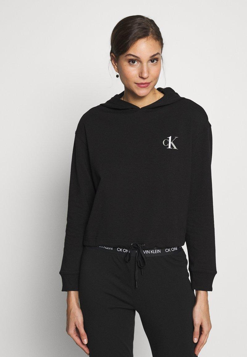 Calvin Klein Underwear - CK ONE LOUNGE FT L/S HOODIE - Pyjama top - black