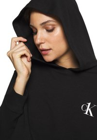 Calvin Klein Underwear - CK ONE LOUNGE FT L/S HOODIE - Pyjama top - black - 3