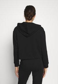 Calvin Klein Underwear - CK ONE LOUNGE FT L/S HOODIE - Pyjama top - black - 2