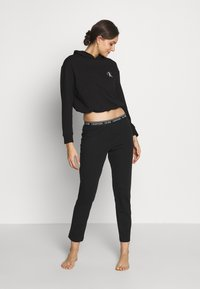 Calvin Klein Underwear - CK ONE LOUNGE FT L/S HOODIE - Pyjama top - black - 1