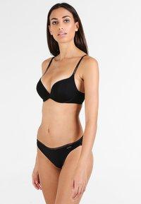 Calvin Klein Underwear - THONG - Tanga - black - 1