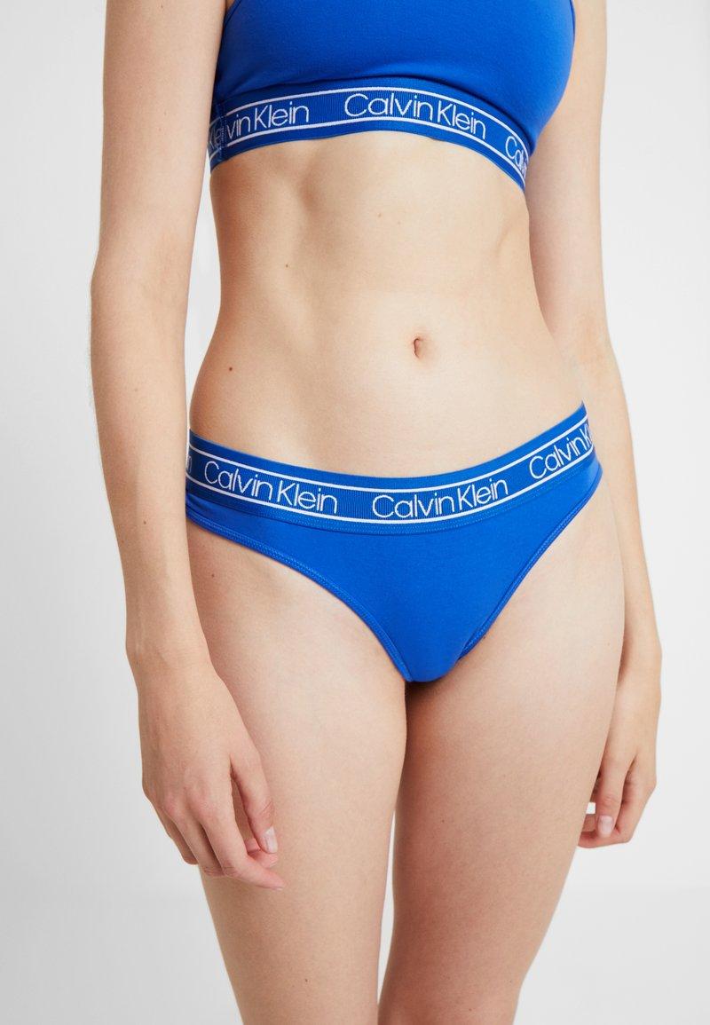 Calvin Klein Underwear - MODERN THONG - Stringi - stellar