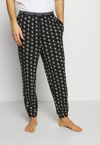 Calvin Klein Underwear - CK ONE JOGGER PYJAMA BOTTOMS - Pyjamabroek - black - 1
