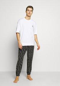 Calvin Klein Underwear - CK ONE JOGGER PYJAMA BOTTOMS - Pyjamabroek - black - 0