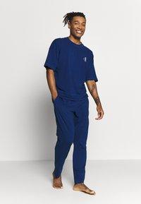 Calvin Klein Underwear - CK ONE SLEEP PANT - Pyjamabroek - blue - 1