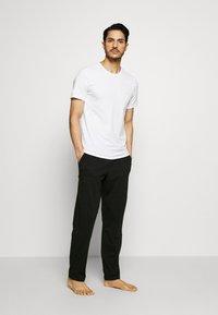 Calvin Klein Underwear - CK ONE SLEEP PANT - Pyjamabroek - black - 1