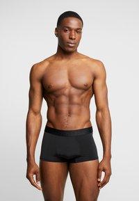 Calvin Klein Underwear - LOW RISE TRUNK - Culotte - black - 1