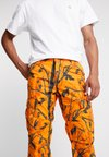 Carhartt WIP - AVIATION PANT COLUMBIA - Cargohose - orange rinsed