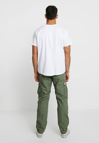 Carhartt WIP - AVIATION PANT COLUMBIA - Cargobyxor - dollar green rinsed - 2