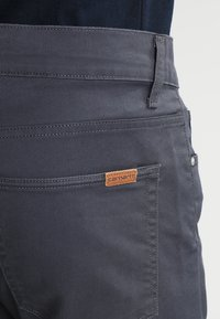 Carhartt WIP - VICIOUS PANT LAMAR - Pantalon classique - blacksmith rinsed - 4