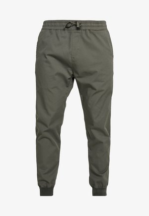 MADISON JOGGER TRABUCO - Trousers - moor rinsed