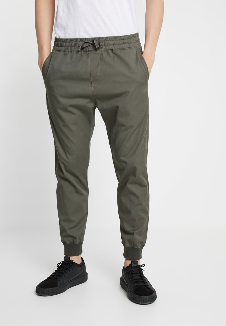 Carhartt WIP - MADISON JOGGER TRABUCO - Trousers - moor rinsed