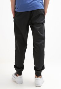 Carhartt WIP - MADISON JOGGER TRABUCO - Trousers - black rinsed - 2