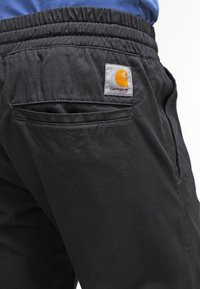 Carhartt WIP - MADISON JOGGER TRABUCO - Trousers - black rinsed - 5