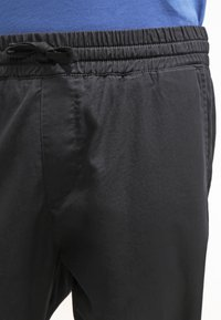 Carhartt WIP - MADISON JOGGER TRABUCO - Trousers - black rinsed - 4