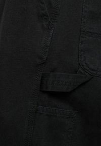 Carhartt WIP - RUCK SINGLE KNEE PANT MILLINGTON - Tygbyxor - black stone washed - 5