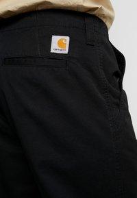 Carhartt WIP - DALLAS PANT - Broek - black stone washed - 4