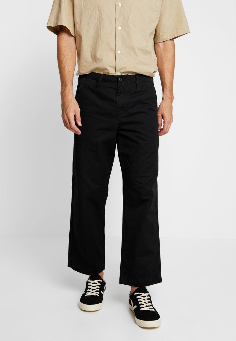 Carhartt WIP - DALLAS PANT - Pantalones - black stone washed