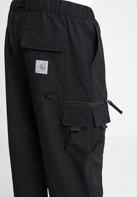 Carhartt WIP - ELMWOOD PANT MECHANICAL STRETCH - Reisitaskuhousut - black - 5
