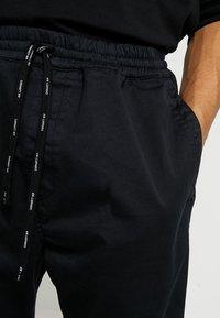 Carhartt WIP - LAWTON PANT VESTAL - Pantalones - black - 3