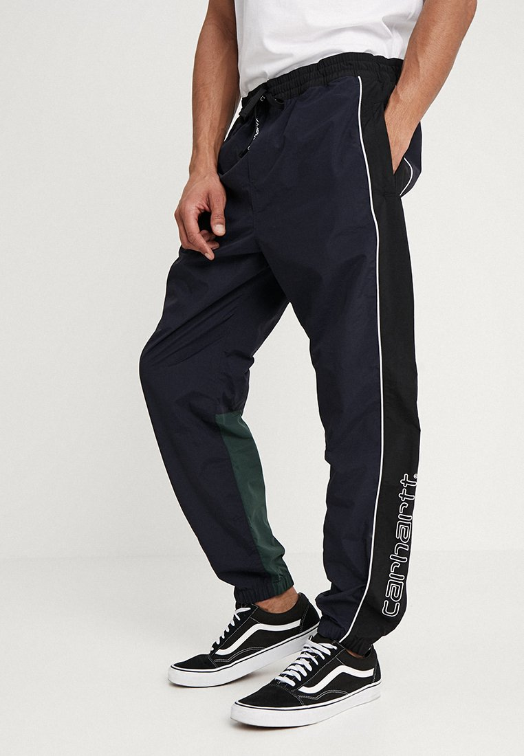 Carhartt WIP - TERRACE PANT - Spodnie treningowe - dark navy/black/bottle green