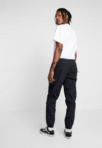 Carhartt WIP - DEXTER PANT - Teplákové kalhoty - black - 2