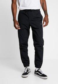 Carhartt WIP - DEXTER PANT - Teplákové kalhoty - black - 0
