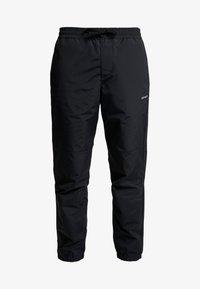 Carhartt WIP - DEXTER PANT - Teplákové kalhoty - black - 4