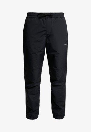 DEXTER PANT - Verryttelyhousut - black