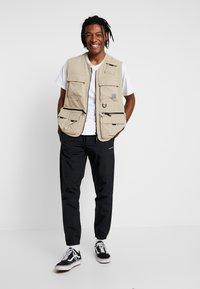 Carhartt WIP - DEXTER PANT - Teplákové kalhoty - black - 1