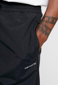 Carhartt WIP - DEXTER PANT - Teplákové kalhoty - black - 5