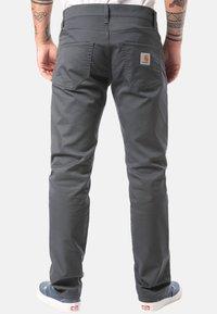 Carhartt WIP - CARHARTT WIP KLONDIKE JEANS - Straight leg jeans - black - 1