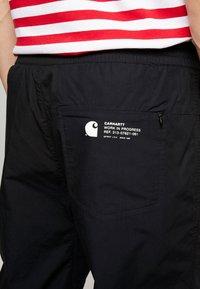 Carhartt WIP - COLEMAN PANTS - Trousers - black/wax - 6