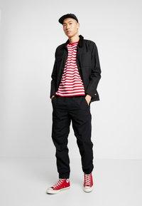 Carhartt WIP - COLEMAN PANTS - Trousers - black/wax - 1