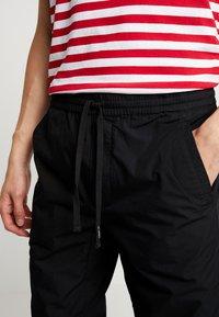 Carhartt WIP - COLEMAN PANTS - Trousers - black/wax - 3