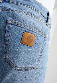 Carhartt WIP - REBEL PANT SPICER - Slim fit -farkut - blue worn bleached - 6