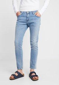 Carhartt WIP - REBEL PANT SPICER - Slim fit -farkut - blue worn bleached - 0
