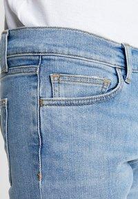 Carhartt WIP - REBEL PANT SPICER - Slim fit -farkut - blue worn bleached - 3