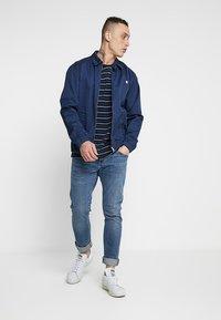 Carhartt WIP - REBEL PANT SPICER - Jeans Slim Fit - blue mid - 1
