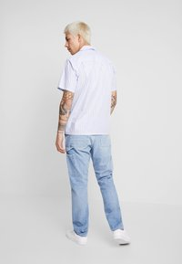 Carhartt WIP - RUCK SINGLE KNEE PANT - Džíny Straight Fit - blue worn bleached - 2
