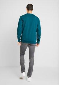 Carhartt WIP - REBEL PANT MARGATE - Jeans slim fit - black - 2