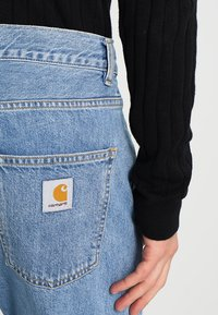 Carhartt WIP - NEWEL PANT MILTON - Relaxed fit jeans - blue stone bleached - 4
