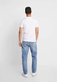 Carhartt WIP - NEWEL PANT MAITLAND - Relaxed fit jeans - blue worn bleached - 2