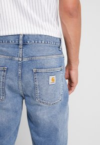 Carhartt WIP - NEWEL PANT MAITLAND - Relaxed fit jeans - blue worn bleached - 5