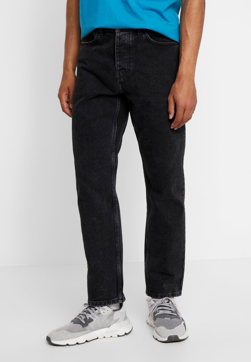 Carhartt WIP - NEWEL PANT MAITLAND - Jeans relaxed fit - black stone washed