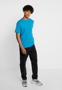 Carhartt WIP - NEWEL PANT MAITLAND - Jeans relaxed fit - black stone washed - 1