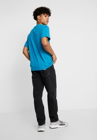 Carhartt WIP - NEWEL PANT MAITLAND - Jeans relaxed fit - black stone washed - 2