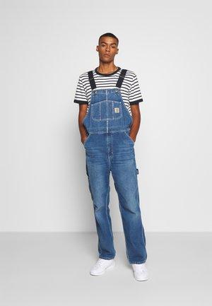 BIB OVERALL - Straight leg jeans - mid worn wash