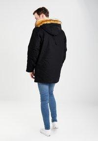 Carhartt WIP - SIBERIAN DEARBORN - Winter coat - black - 2